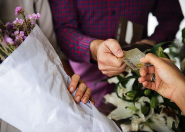 Handing credit card to florist